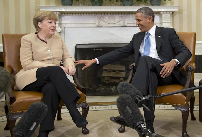 President Barack Obama meets with German Chancellor Angela Merkel in the Oval Office of the White House in Washington, Friday, May 2, 2014. Obama and Merkel are mounting a display of trans-Atlantic unity against an assertive Russia, even as sanctions imposed by Western allies seem to be doing little to change Russian President Vladimir Putin's reasoning on Ukraine. (AP Photo/Carolyn Kaster)