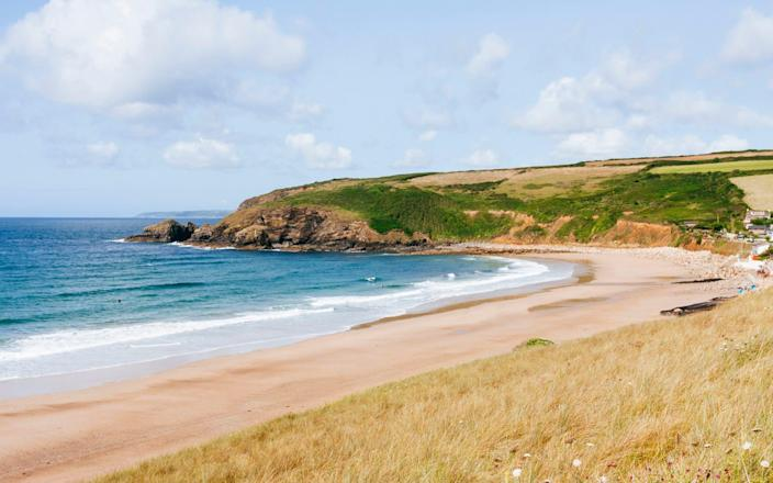 Long stretch of beach at Praa Sands - lleerogers/iStockphoto