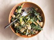 """This combo of kale and cabbage with a sweet onion dressing costs less than <a href=""""https://www.epicurious.com/recipes-menus/kale-salad-picnic-budget-article?mbid=synd_yahoo_rss"""" rel=""""nofollow noopener"""" target=""""_blank"""" data-ylk=""""slk:$2 per serving"""" class=""""link rapid-noclick-resp"""">$2 per serving</a> and has a crunch factor that comes from the addition of onion-flavored potato chips. <a href=""""https://www.epicurious.com/recipes/food/views/maui-kale-salad-with-sweet-onion-dressing-sheldon-simeon-cook-real-hawaii?mbid=synd_yahoo_rss"""" rel=""""nofollow noopener"""" target=""""_blank"""" data-ylk=""""slk:See recipe."""" class=""""link rapid-noclick-resp"""">See recipe.</a>"""