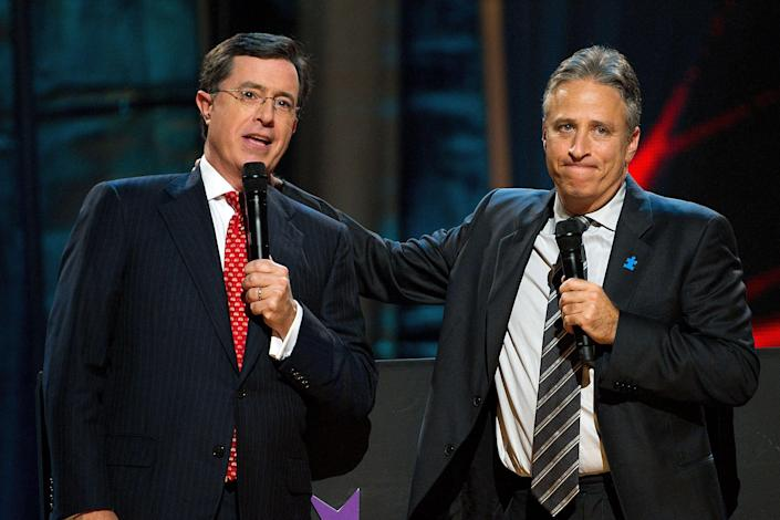 Stephen Colbert, left, and Jon Stewart appear on stage at Comedy Central's 'Night Of Too Many Stars: An Overbooked Concert For Autism Education' at the Beacon Theatre in New York, Saturday, October 2, 2010. (AP Photo/Charles Sykes)