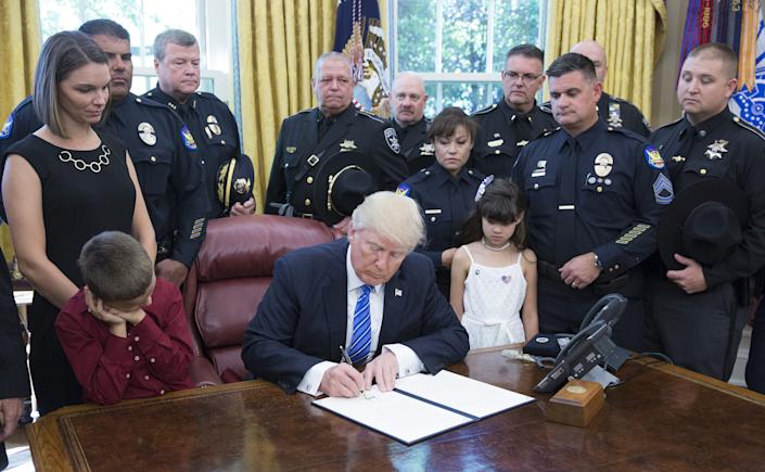 President Donald Trump signs a proclamation supporting police officers at the White House on May 15, 2017 in Washington, DC.