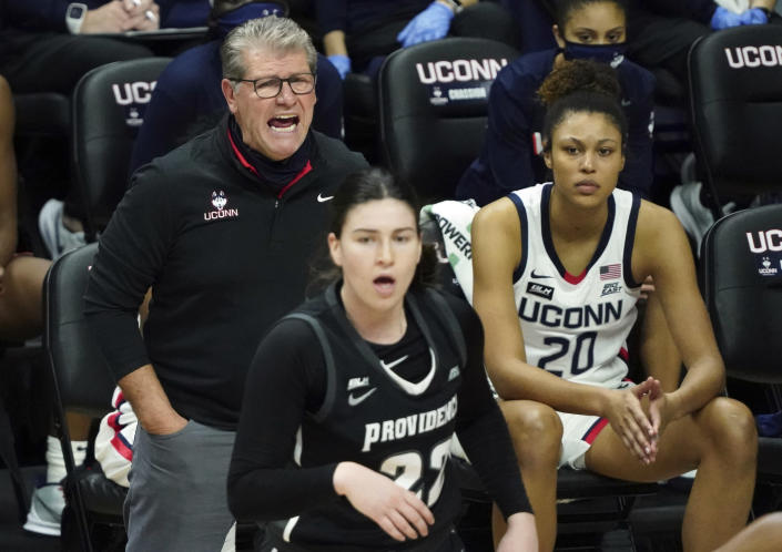 Connecticut head coach Geno Auriemma shouts from the sideline during the first half of an NCAA college basketball game against Providence at Harry A. Gampel Pavilion, Saturday, Jan. 9, 2021, in Storrs, Conn. (David Butler II/Pool Photo via AP)