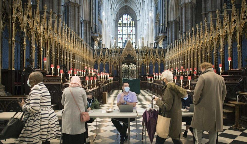 People arrive to receive their Covid-19 vaccines at Westminster Abbey in London. Photo: AP