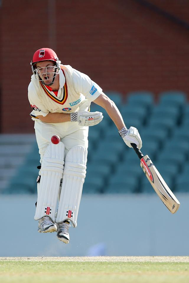 ADELAIDE, AUSTRALIA - OCTOBER 25:  Michael Klinger of the Redbacks is hit by the ball while batting during day three of the Sheffield Shield match between the South Australian Redbacks and the Queensland Bulls at Adelaide Oval on October 25, 2012 in Adelaide, Australia.  (Photo by Morne de Klerk/Getty Images)