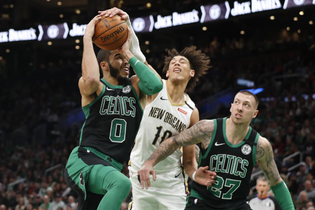 New Orleans Pelicans' Jaxson Hayes goes for the ball held by Boston Celtics' Jayson Tatum during the first quarter of an NBA basketball game Saturday, Jan. 11, 2020, in Boston. (AP Photo/Winslow Townson)