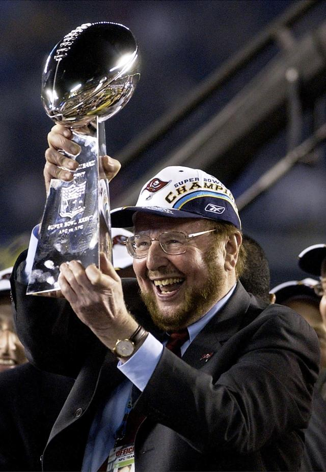 Tampa Bay Buccaneers' owner Malcolm Glazer holds the Vince Lombardi trophy after Super Bowl XXXVII, in which his team defeated the Oakland Raiders, 48-21, in San Diego, California in this file photo from January 26, 2003. Glazer, 85, owner of English football club Manchester United and American football franchise Tampa Bay Buccaneers, died on May 28, 2014, according to reports. REUTERS/Tim Shaffer/Files (UNITED STATES - Tags: SPORT FOOTBALL OBITUARY)