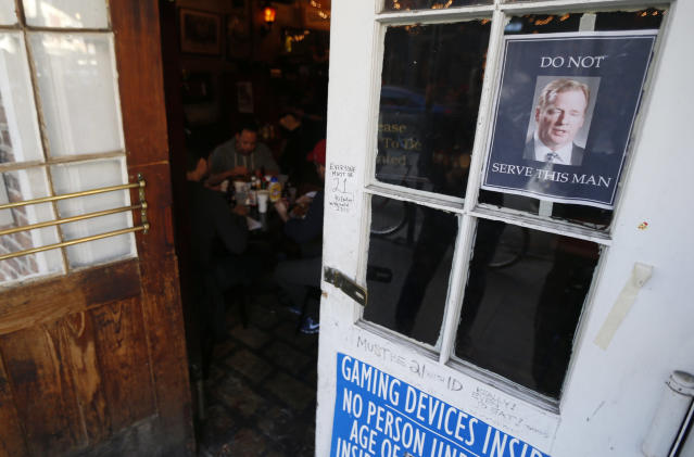 A photograph of NFL football commissioner Roger Goodell, top right, is posted on the door of the Coop's Place restaurant, Thursday, Jan. 31, 2013, in New Orleans, La. New Orleans is preparing for the NFL football Super Bowl on Sunday and several restaurants have posted signs against serving Goodell. (AP Photo/Julio Cortez)