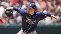 Tampa Bay Rays starting pitcher Ryan Yarbrough delivers in the first inning of a baseball game against the Cleveland Indians, Sunday, July 25, 2021, in Cleveland. (AP Photo/Tony Dejak)