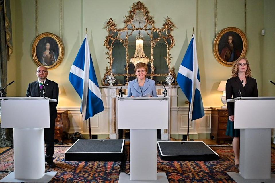 First Minister Nicola Sturgeon (centre) and Scottish Green Party co-leaders Patrick Harvie (left) and Lorna Slater (right) as the draft agreement was announced at Bute House, Edinburgh (Jeff J Mitchell/PA) (PA Wire)