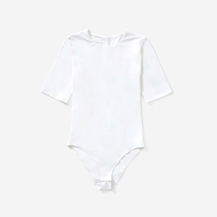 """<p><a class=""""link rapid-noclick-resp"""" href=""""https://go.redirectingat.com?id=127X1599956&url=https%3A%2F%2Fwww.everlane.com%2Fproducts%2Fwomens-ss-crew-bodysuit-white&sref=https%3A%2F%2Fwww.harpersbazaar.com%2Fuk%2Ffashion%2Fwhat-to-wear%2Fg27282427%2Fbest-white-t-shirt-women%2F"""" rel=""""nofollow noopener"""" target=""""_blank"""" data-ylk=""""slk:SHOP NOW"""">SHOP NOW</a></p><p><a href=""""https://www.harpersbazaar.com/uk/fashion/shows-trends/news/a42868/low-rise-jeans-trend-2017/"""" rel=""""nofollow noopener"""" target=""""_blank"""" data-ylk=""""slk:Low-rise jeans"""" class=""""link rapid-noclick-resp"""">Low-rise jeans</a> and trousers are creeping back in from their noughties graves thanks to the likes of <a href=""""https://www.harpersbazaar.com/uk/fashion/shows-trends/a26646704/justine-picardie-reviews-karl-lagerfelds-final-chanel-show/"""" rel=""""nofollow noopener"""" target=""""_blank"""" data-ylk=""""slk:Chanel"""" class=""""link rapid-noclick-resp"""">Chanel</a> and <a href=""""https://www.harpersbazaar.com/uk/fashion/fashion-news/a26820800/remembering-my-uncle-alexander-mcqueen-it-was-always-about-the-shock-factor-with-lee/"""" rel=""""nofollow noopener"""" target=""""_blank"""" data-ylk=""""slk:Alexander McQueen"""" class=""""link rapid-noclick-resp"""">Alexander McQueen</a>. If you're planning on tackling this trend, we suggest you invest in a bodysuit asap. And if you're not, buy one anyway. Everlane's version will create a smooth silhouette under jeans and cigarette pants.</p><p>Short-Sleeve Crew Neck Bodysuit, £28, Everlane</p>"""