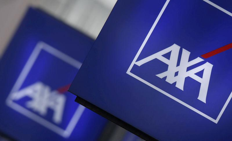FILE PHOTO - Logos of France's biggest insurer Axa are seen on a building in Nanterre