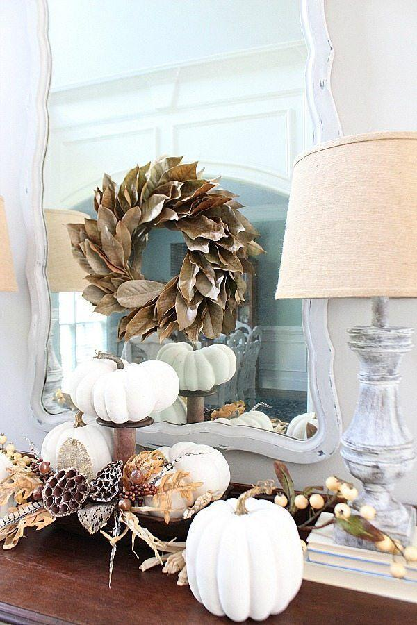 """<p>The pumpkins you see here are actually painted faux versions of the real thing, but both options work. Consider adding a pedestal or two for height and visual interest.</p><p><strong>Get the tutorial at <a href=""""https://refreshrestyle.com/painted-fall-pumpkins/"""" rel=""""nofollow noopener"""" target=""""_blank"""" data-ylk=""""slk:Refresh Restyle"""" class=""""link rapid-noclick-resp"""">Refresh Restyle</a>.</strong></p><p><strong><a class=""""link rapid-noclick-resp"""" href=""""https://go.redirectingat.com?id=74968X1596630&url=https%3A%2F%2Fwww.walmart.com%2Fsearch%2F%3Fquery%3Dfarmhouse%2Bmirrors&sref=https%3A%2F%2Fwww.thepioneerwoman.com%2Fhome-lifestyle%2Fdecorating-ideas%2Fg36664123%2Fwhite-pumpkin-decor-ideas%2F"""" rel=""""nofollow noopener"""" target=""""_blank"""" data-ylk=""""slk:SHOP FARMHOUSE MIRRORS"""">SHOP FARMHOUSE MIRRORS</a></strong></p>"""