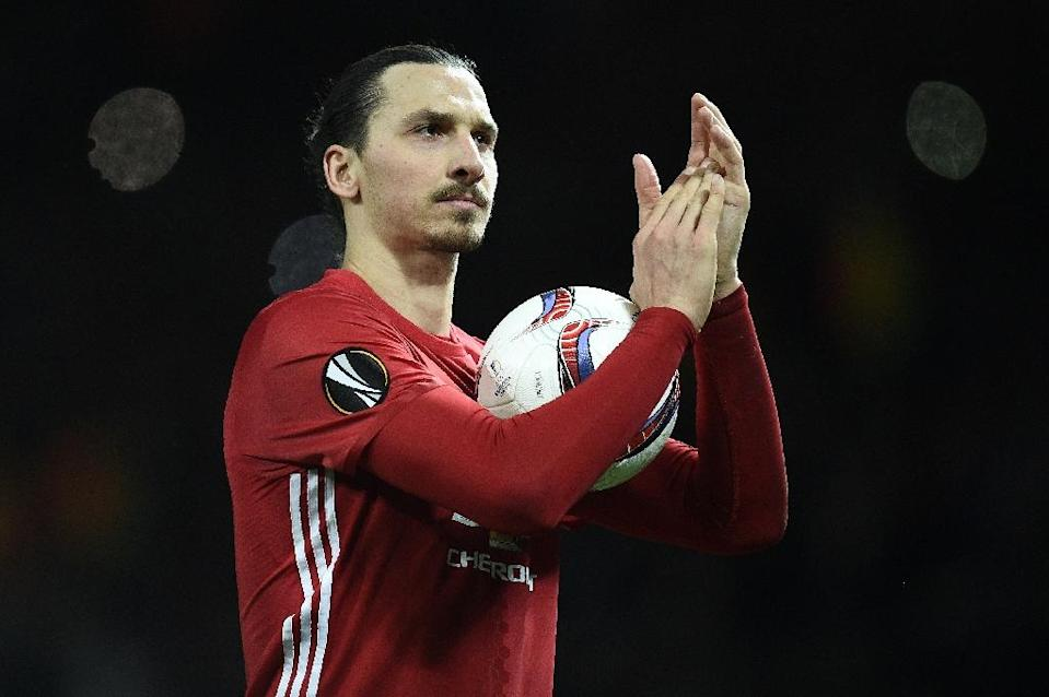 """Zlatan Ibrahimovic is targeting Premier League glory with Manchester United as he plots his return from a serious knee injury to """"finish what I started"""" (AFP Photo/Oli SCARFF )"""