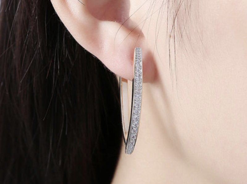 Swarovski Crystal Micro-Pav'e Curved Huggie Earrings In 18K Plated Gold. (Photo: StackCommerce)