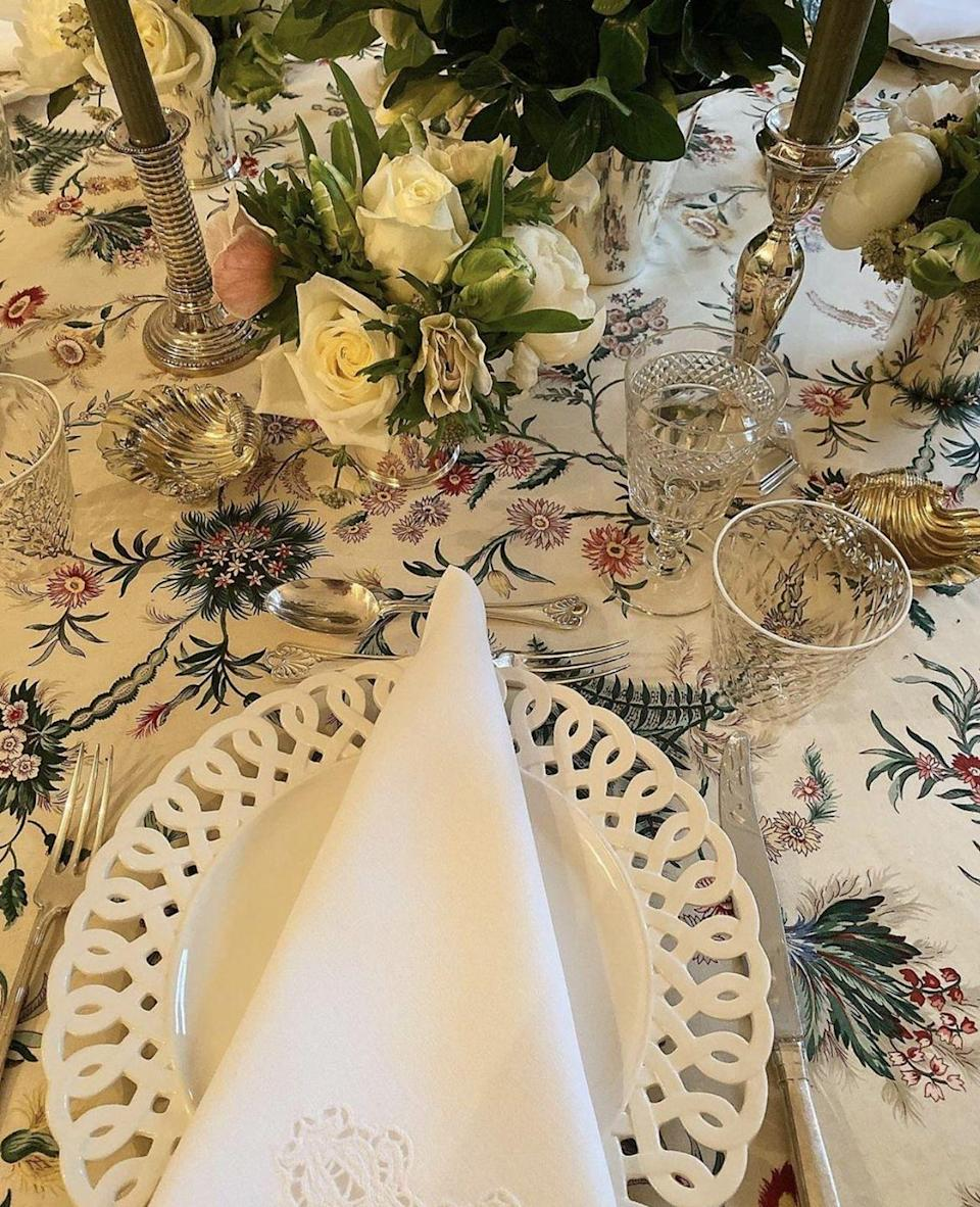"""<p>You can never go wrong with white roses! <a href=""""https://www.aerin.com/"""" rel=""""nofollow noopener"""" target=""""_blank"""" data-ylk=""""slk:Aerin Lauder"""" class=""""link rapid-noclick-resp"""">Aerin Lauder</a> opts for the classic approach when setting the table for one of her fall dinner parties. Smaller arrangements in silver cups are the ultimate sophisticated centerpiece.</p>"""