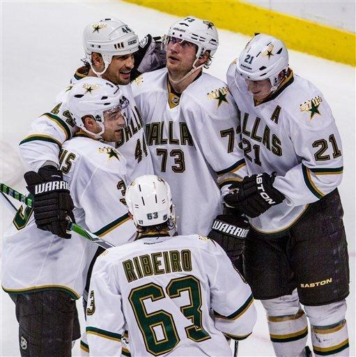 Dallas Stars' including Michael Ryder(73), Loui Ericksson(21), Stephane Robidas(3), Sheldon Souray and Mike Ribeiro congratulate each other after Eriksson scored the third goal of the third period for the Stars as the Dallas Stars beat the Chicago Blackhawks 3-1 in an NHL hockey game in Chicago on Thursday, Feb. 23, 2012. (AP Photo/Charles Cherney)