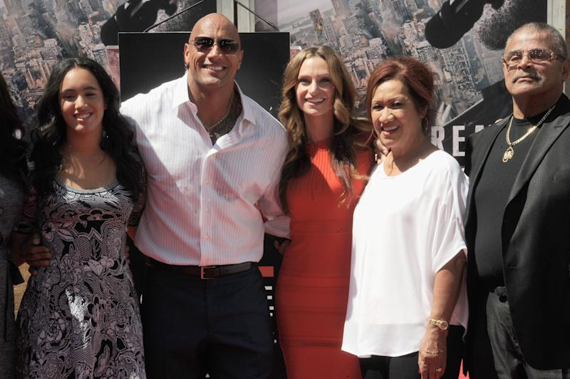 Dwayne Johnson with his family at a film premiere.