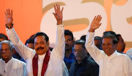 FILE PHOTO: Sri Lanka's newly appointed Prime Minister Mahinda Rajapaksa and President Maithripala Sirisena wave at their supporters during a rally near the parliament in Colombo, Sri Lanka November 5, 2018. REUTERS/Dinuka Liyanawatte/File Photo