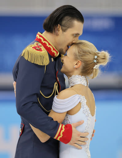 Tatiana Volosozhar and Maxim Trankov of Russia embrace after competing in the pairs short program figure skating competition at the Iceberg Skating Palace during the 2014 Winter Olympics, Tuesday, Feb. 11, 2014, in Sochi, Russia. (AP Photo/Vadim Ghirda)