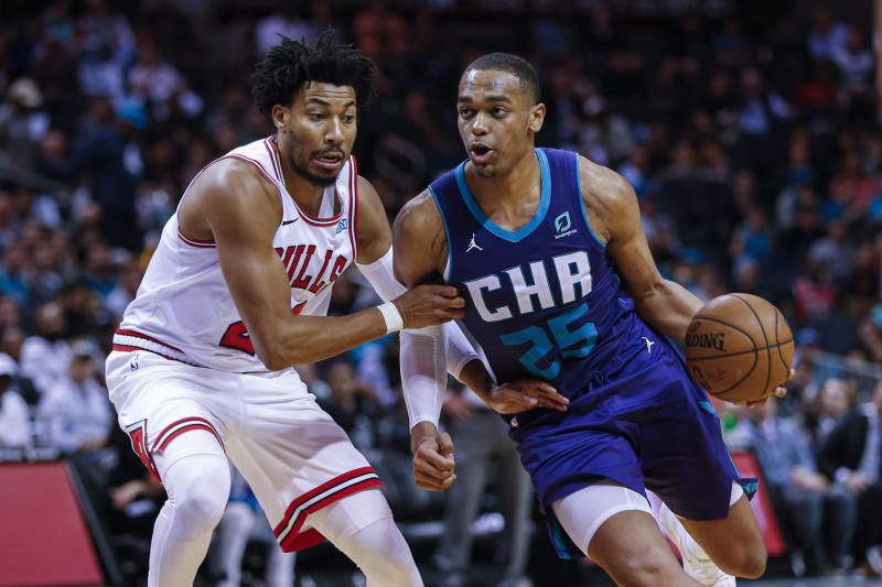P.J. Washington broke a rookie record and helped the Hornets set a team record in a hot-shooting debut. (AP Photo/Nell Redmond)