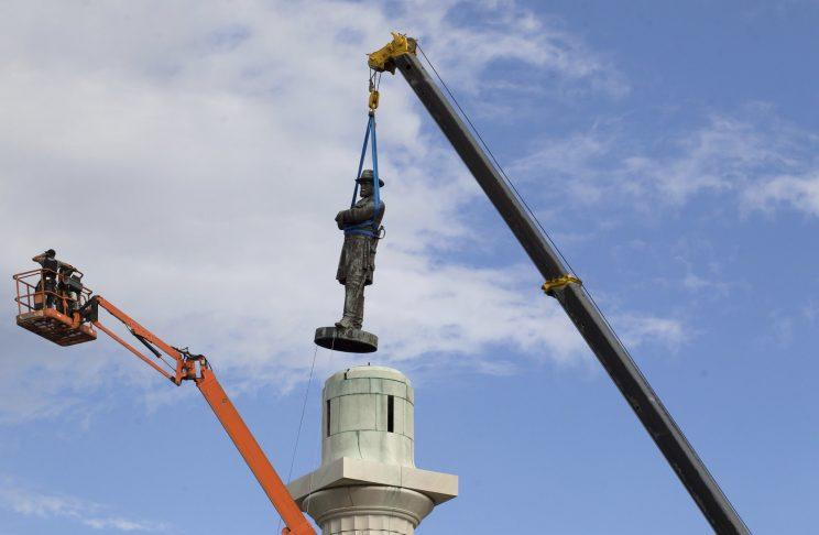A statue of Confederate General Robert E. Lee being removed from a pedestal in New Orleans