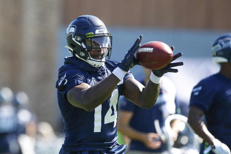 Jul 25, 2019; Renton, WA, USA; Seattle Seahawks wide receiver D.K. Metcalf (14) catches a pass during a training camp practice drill at the Virginia Mason Athletic Center. Mandatory Credit: Joe Nicholson-USA TODAY Sports