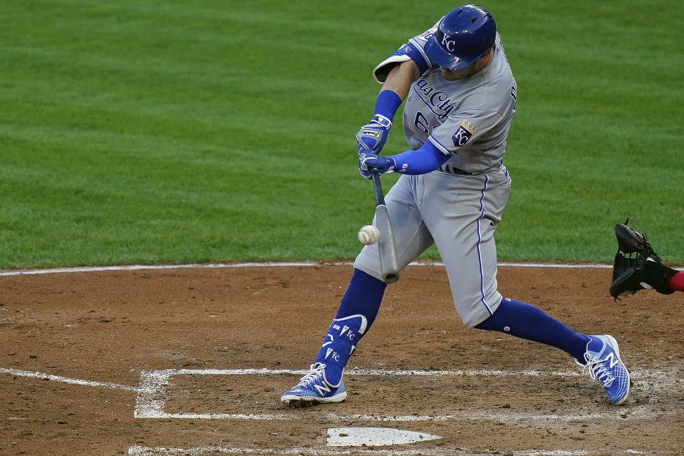 Kansas City Royals first baseman Ryan O'Hearn (66) hits an RBI single during the third inning of a baseball game against the Cincinnati Reds at Great American Ballpark in Cincinnati, Tuesday, Aug. 11, 2020. (AP Photo/Bryan Woolston)