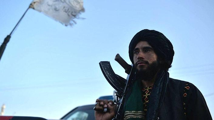 A Taliban fighter stands at a roadside in Herat, 19 September 2021