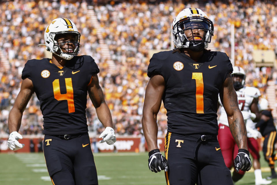 Tennessee wide receiver Velus Jones Jr. (1) looks at the Jumbotron after scoring a touchdown as wide receiver Cedric Tillman (4) joins him during the first half of an NCAA college football game against South Carolina, Saturday, Oct. 9, 2021, in Knoxville, Tenn. (AP Photo/Wade Payne)