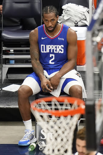 Los Angeles Clippers forward Kawhi Leonard sits on the bench during the first half of the team's NBA basketball game against the Utah Jazz on Friday, Jan. 1, 2021, in Salt Lake City. (AP Photo/Rick Bowmer)