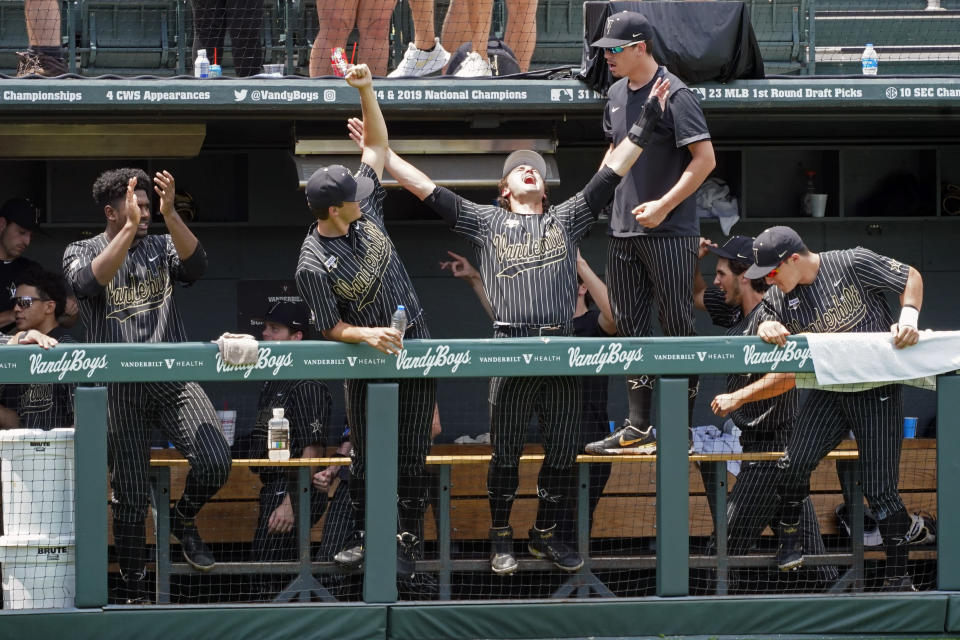 Vanderbilt players celebrate after a call at the plate was reversed and Vanderbilt was awarded a run during the eighth inning of an NCAA college baseball super regional game against East Carolina, Friday, June 11, 2021, in Nashville, Tenn. Vanderbilt won 2-0. (AP Photo/Mark Humphrey)
