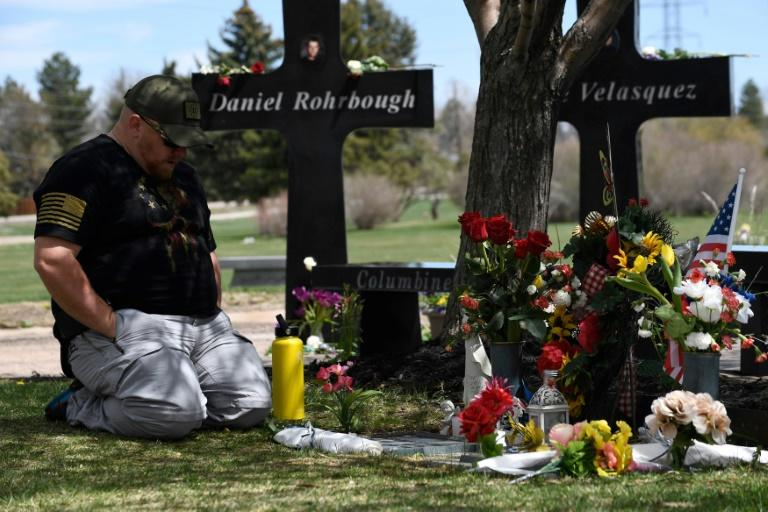 A man visits the memorial for victims of the 1999 Columbine High School shooting at the Chapel Hill Memorial Gardens in Littleton, Colorado in April 2019 (AFP Photo/Jason Connolly)