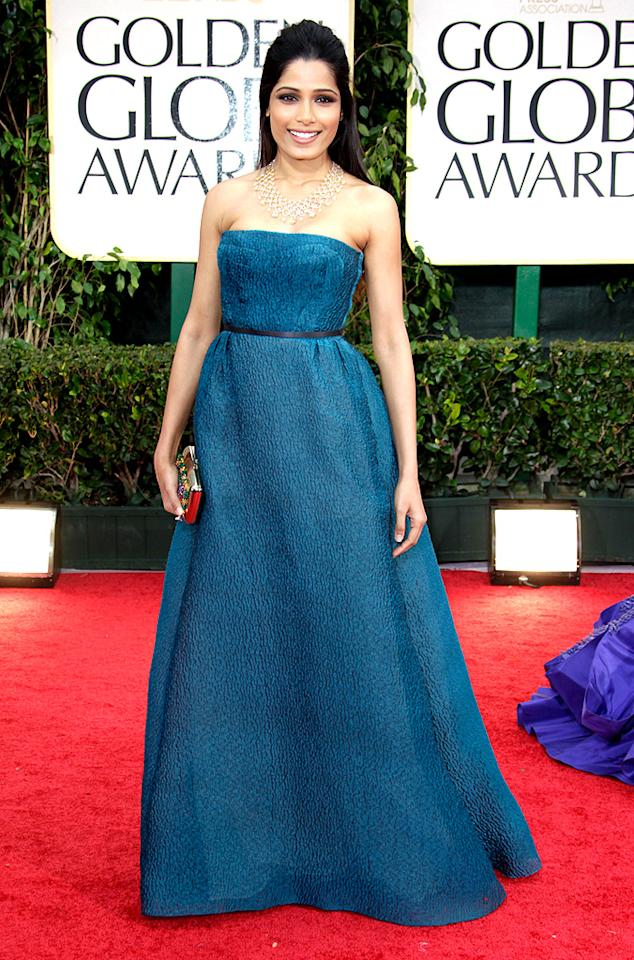 """<span style=""""font-family:Arial;""""><strong>Freida Pinto</strong><br><strong>Grade: B<br><br></strong></span><span style=""""font-size:12pt;"""">While Freida Pinto stunned in her Prada gown and gorgeous Chopard necklace (and really, when <em>doesn't </em>she look fab?), we would've preferred to see the """"Slumdog Millionaire"""" star show off her svelte bod in a more form-fitting dress. </span><br><span style=""""font-family:Arial;""""><strong><br></strong></span>"""