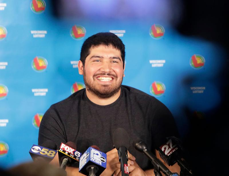 Manuel Franco of West Allis, Wis., winner of second-highest Powerball lottery in history, appears during a press conference at the Wisconsin Department of Revenue, in Madison, Wis. Tuesday, April 23, 2019. Franco claimed the cash option payout of the prize, totaling approximately $477 million before taxes. The overall jackpot of the prize, drawn March 22, was $768,400. (John Hart/Wisconsin State Journal via AP)