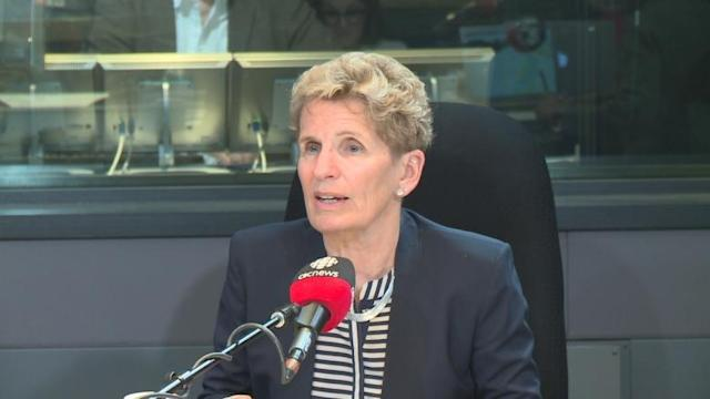 Premier Kathleen Wynne defends minimum wage announcement in Metro Morning appearance