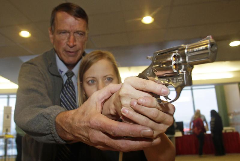 FILE - In this Dec. 27, 2012 file photo, Cori Sorensen, a fourth grade teacher from Highland Elementary School in Highland, Utah, receives firearms training with a .357 magnum from personal defense instructor Jim McCarthy in West Valley City, Utah, where teachers and administrators are allowed to bring guns to school. Lawmakers in many Republican-led states proposed arming school personnel with guns following a mass shooting at a Connecticut school, yet four months later the quest has stalled in many traditionally gun-friendly states. (AP Photo/Rick Bowmer, File)