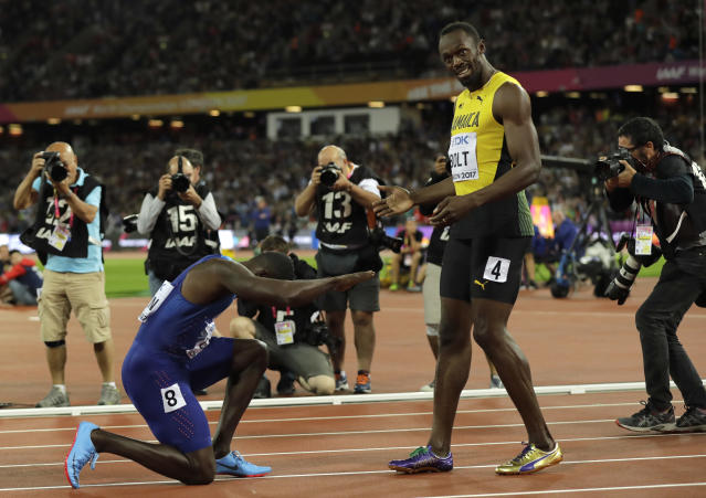 FILE - In this Saturday, Aug. 5, 2017 file photo United States' Justin Gatlin bows to Jamaica's Usain Bolt after winning the Men's 100 meters final during the World Athletics Championships in London. (AP Photo/Tim Ireland, File)