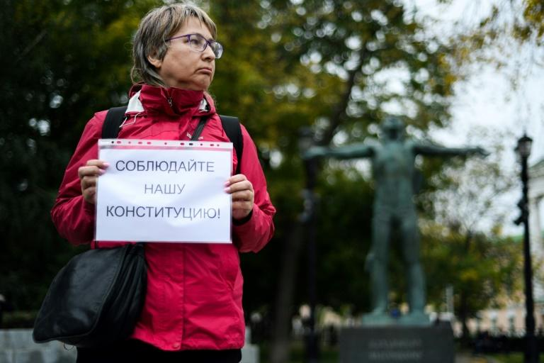 A Russian opposition activist holds a placard reading 'Respect our Constitution' during the one-persons protests in central Moscow (AFP Photo/Kirill KUDRYAVTSEV)