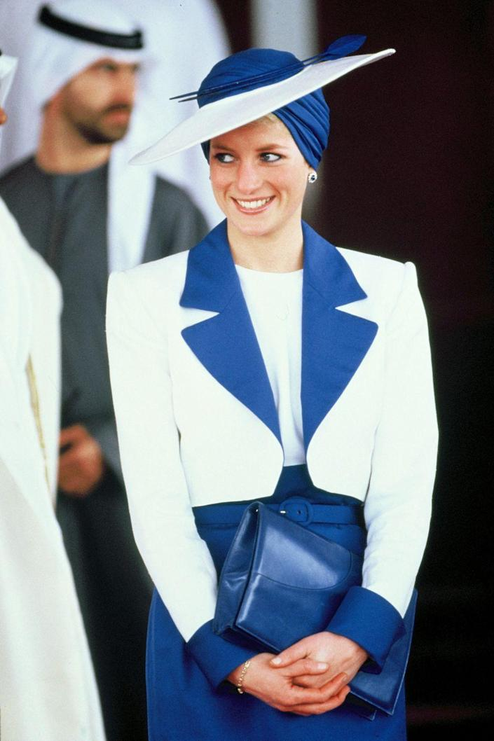 <p>Princess Diana in a blue-and-white suited look and matching hat. </p>