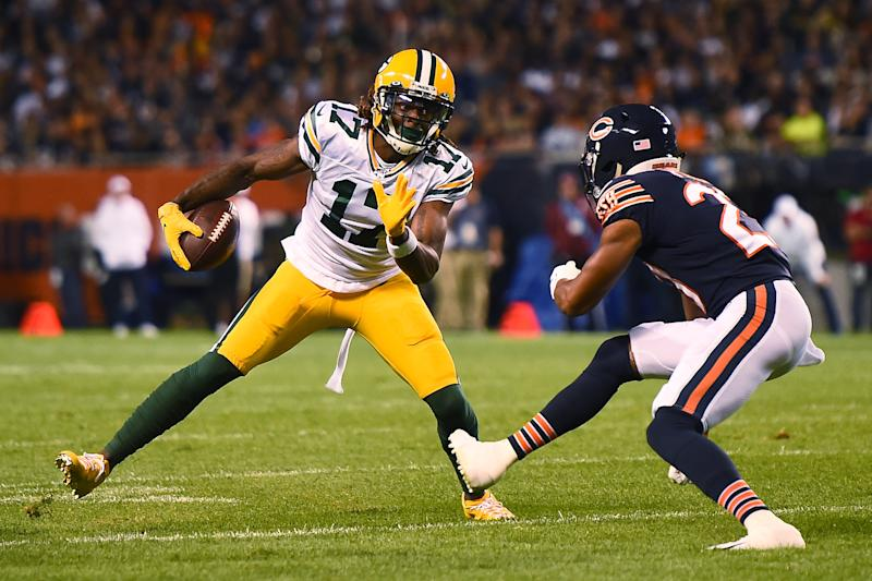 CHICAGO, ILLINOIS - SEPTEMBER 05: Davante Adams #17 of the Green Bay Packers avoids a tackle by Kyle Fuller #23 of the Chicago Bears during a game at Soldier Field on September 05, 2019 in Chicago, Illinois. (Photo by Stacy Revere/Getty Images)