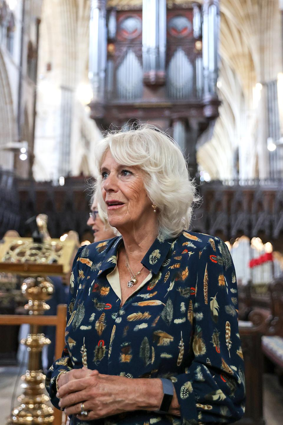 EXETER, UNITED KINGDOM - JULY 19: Camilla, Duchess of Cornwall during a visit to Exeter Cathedral on July 19, 2021 in Exeter, United Kingdom. Founded in 1050, The Cathedral continues to offer daily Christian worship and choral music, alongside its roles as a community hub, heritage destination and venue for concerts and events. It is home to an extensive library and archive, housing important treasures such as the Exeter Book – thought to be the world's oldest surviving book of English literature. The visit celebrates the city's designation as a UNESCO City of Literature and launch of The Royal College of Nursing's Prince of Wales Nursing Cadet Scheme in England.  (Photo by Chris Jackson - WPA Pool/Getty Images)