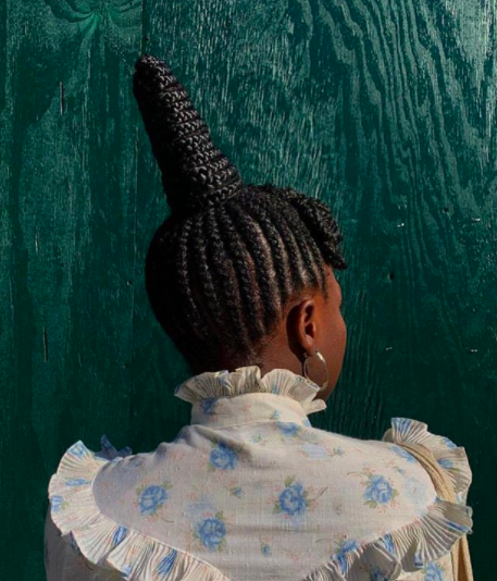 """Take your braids to new heights with <a href=""""https://www.instagram.com/p/BtbslcFlv-9/?igshid=32h38zpx05t4"""" rel=""""nofollow noopener"""" target=""""_blank"""" data-ylk=""""slk:this regal updo"""" class=""""link rapid-noclick-resp"""">this regal updo</a>, created by Koudou. Inspired by Yoruba royalty, it's a style that not only causes you to stop in awe, but also pays homage to the ancestors long before us who developed intricate and innovative patterns to take care of their natural locks."""