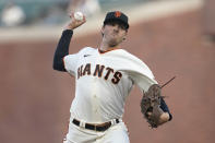 San Francisco Giants pitcher Kevin Gausman throws to a Cincinnati Reds batter during the first inning of a baseball game in San Francisco, Tuesday, April 13, 2021. (AP Photo/Jeff Chiu)