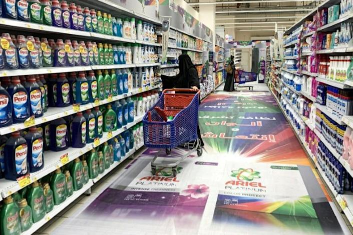 People shop at a supermarket in Riyadh. Multiple Saudi supermarket chains have announced they are stopping the import and sale of Turkish products