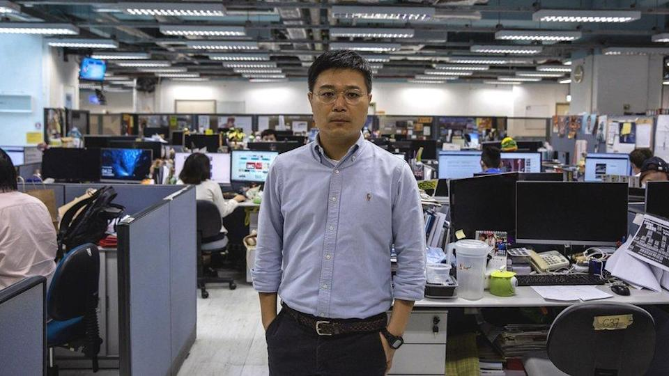 Apple Daily editor-in-chief Ryan Law posing for a portrait in the newsroom in Hong Kong