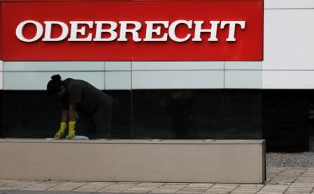 FILE PHOTO: A worker cleans the corporate logo of the Odebrecht SA construction conglomerate at its headquarters in Sao Paulo