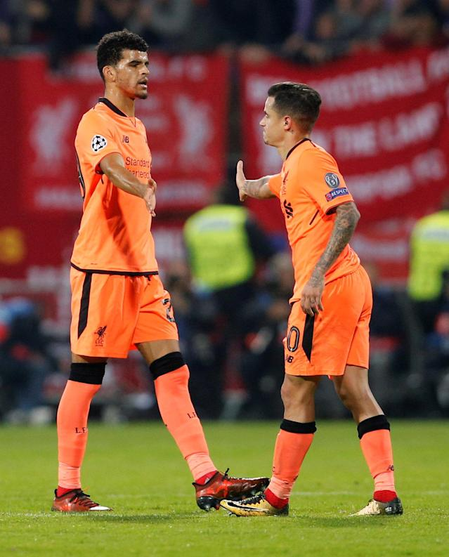Soccer Football - Champions League - Maribor vs Liverpool - Ljudski vrt, Maribor, Slovenia - October 17, 2017 Liverpool's Philippe Coutinho and Dominic Solanke celebrate at the end of the match REUTERS/Srdjan Zivulovic