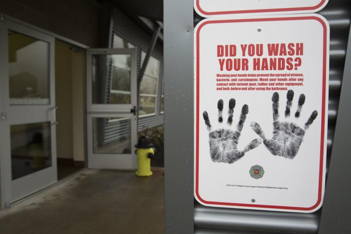 "<span class=""caption"">Outside a dormitory at the Washington State Patrol Fire Training Academy, a sign reminds people to wash their hands.</span> <span class=""attribution""><a class=""link rapid-noclick-resp"" href=""https://www.gettyimages.com/detail/news-photo/sign-reminding-people-to-wash-their-hands-is-pictured-news-photo/1199079526?adppopup=true"" rel=""nofollow noopener"" target=""_blank"" data-ylk=""slk:Getty Images / Jason Redmond"">Getty Images / Jason Redmond</a></span>"
