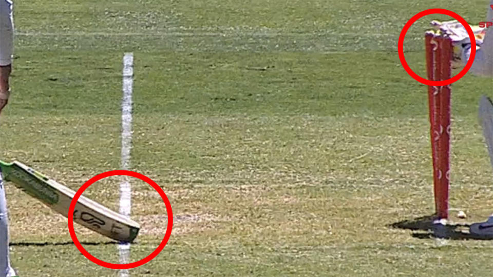 The third umpire gave Australian captain Tim Paine a reprieve on this attempted run-out, with many suggested India were hard done by not to be given the wicket. Picture: Channel 7