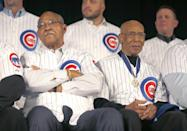 FILE - In this Jan. 17, 2014, file photo, Chicago Cubs Hall of Famers Billy Williams, front left, and Ernie Banks attend the baseball team's annual winter convention in Chicago. Banks, the two-time MVP who never lost his boundless enthusiasm for baseball despite years of playing on losing Cubs teams, died Friday night, Jan. 23, 2015. He was 83. The Cubs announced Banks' death, but did not provide a cause. (AP Photo/Charles Rex Arbogast, File)